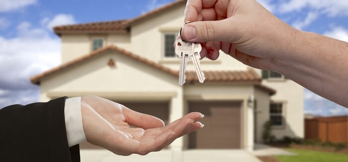 handing over house keys in front of the house