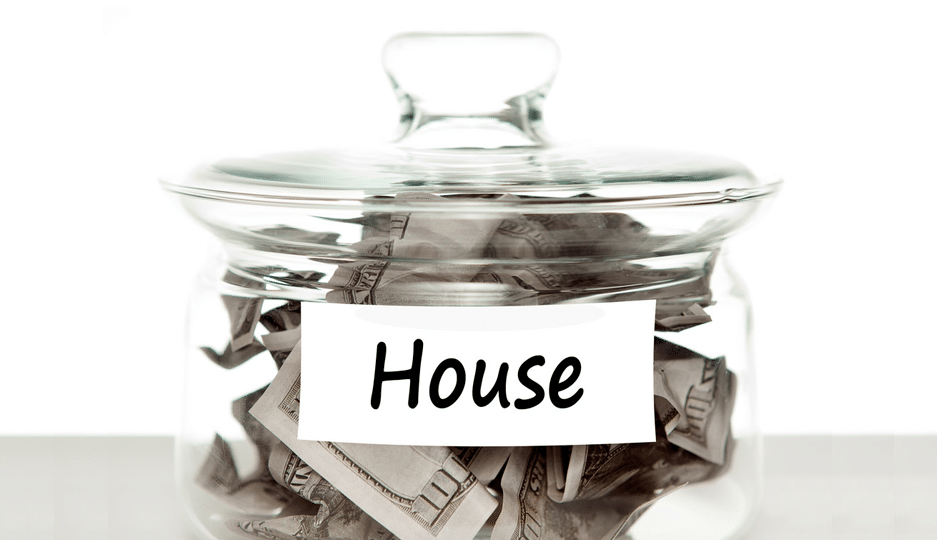 """Thinking of buying a home but don't have a 20 percent down payment? If you take a look at these types of loans, you may be pleasantly surprised. Photo of money jar labeled """"house."""""""