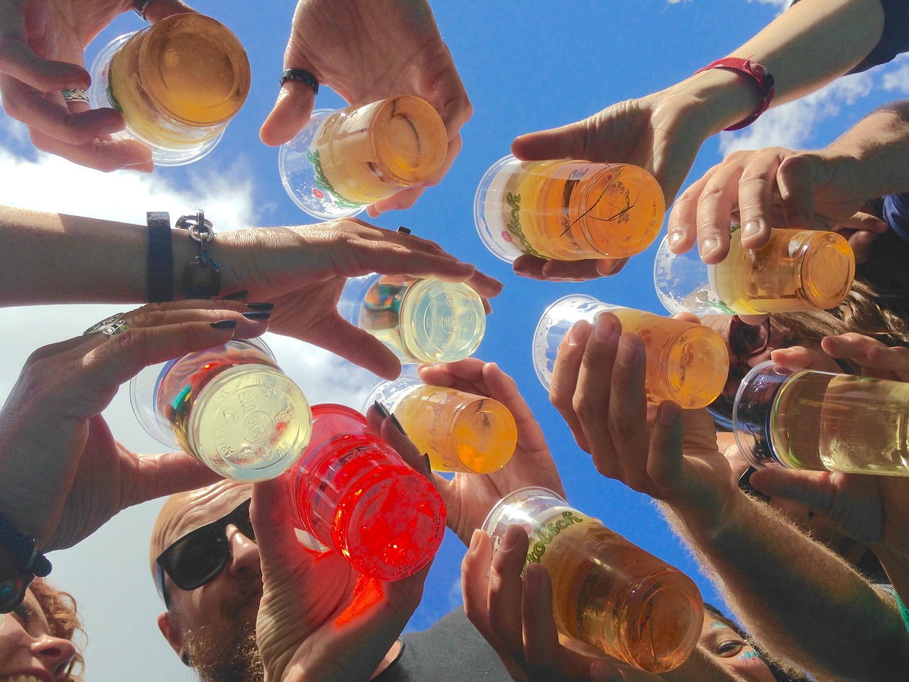 circle of friends drinking different alcoholic drinks
