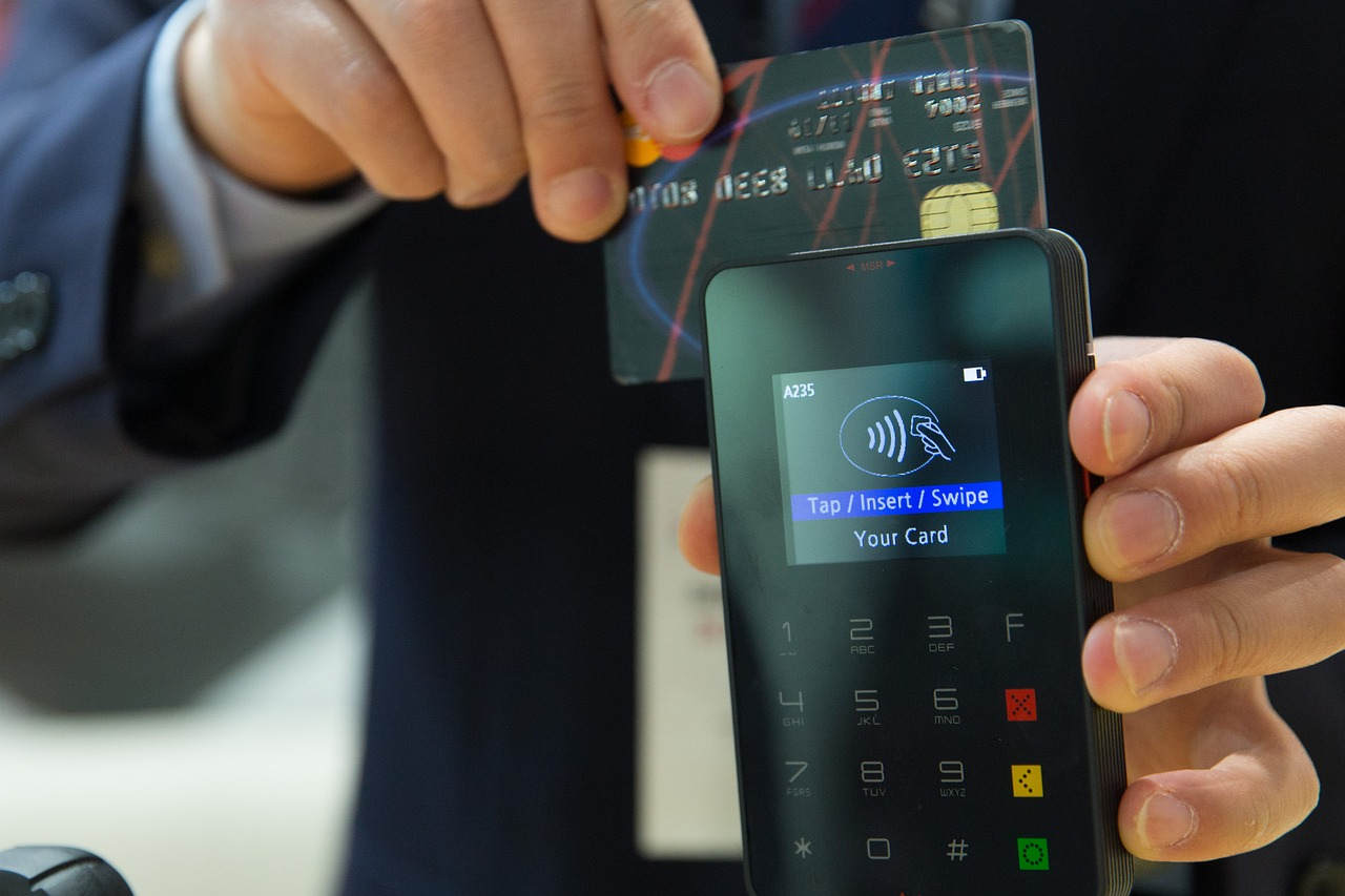 person swiping credit card for payment